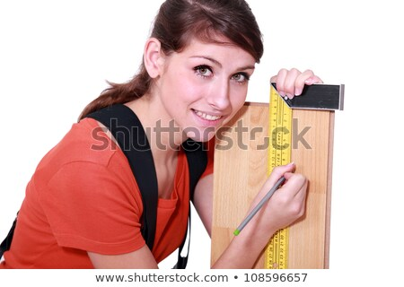 woman marking plank of wood using set square stock photo © photography33