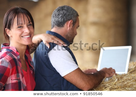 Farmer with a laptop on a haystack stock photo © photography33