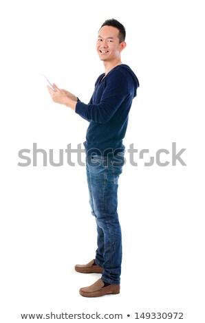 fullbody asian man using tablet stock photo © szefei