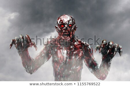zombie stretching bloody hands stock photo © elisanth