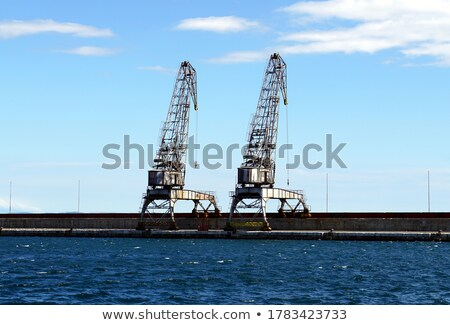 Two rusty cranes Stock photo © dutourdumonde