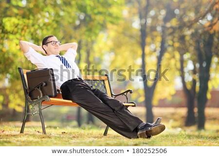 jovem · homem · de · negócios · relaxante · quebrar · banco - foto stock © involvedchannel