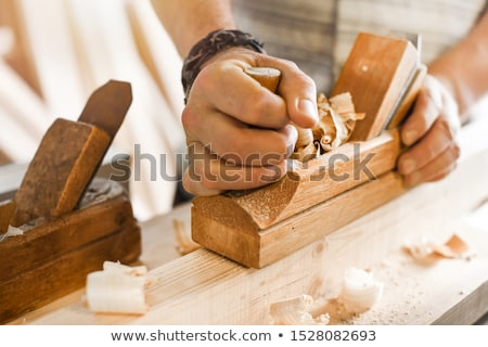 A carpenter using a chisel. Stock photo © photography33