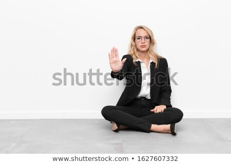 Stern looking blond businesswoman Stock photo © photography33