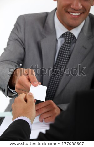 Man handing over his business card to a potential client Stock photo © photography33