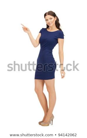 attractive businesswoman pointing her hand Stock photo © dolgachov