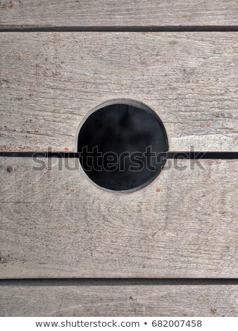 round hole in the wooden wall Stock photo © ultrapro