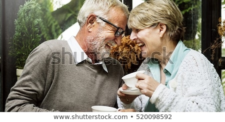 happy smiling couple in restaurant stock photo © juniart