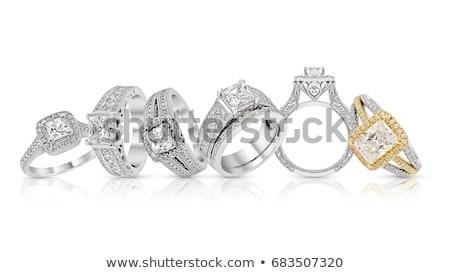 Stock photo: ring set with precious stones on white
