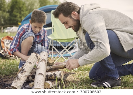 casual man crouched outdoor stock photo © feedough