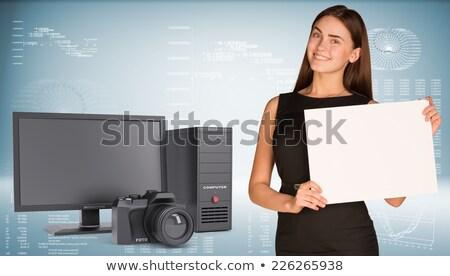 SLR camera on a hi-tech blue background Stock photo © cherezoff