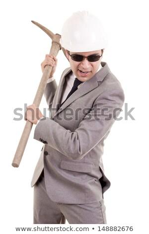 Man in suit displaying pick-axe Stock photo © pxhidalgo