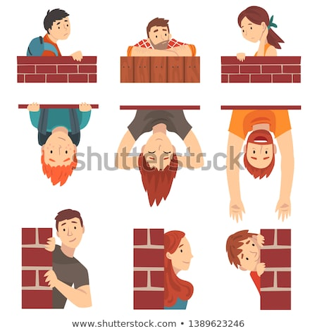 Woman look out behind wall from brick Stock photo © vetdoctor