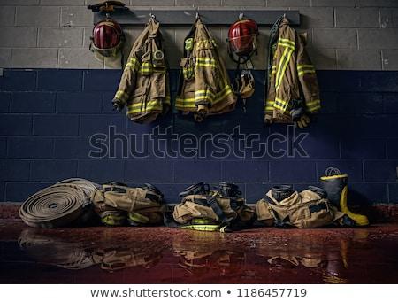 bombeiro · engrenagem · capacete · machado · botas · fogo - foto stock © reicaden