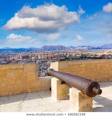 Alicante skyline and old canyons of Santa Barbara Castle Stock photo © lunamarina