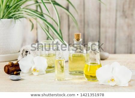 Jaune orchidée bougies spa pierres brûlant Photo stock © Tagore75