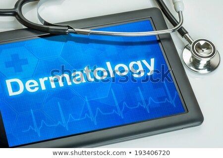 Tablet with the medical specialty Dermatology on the display Stock photo © Zerbor