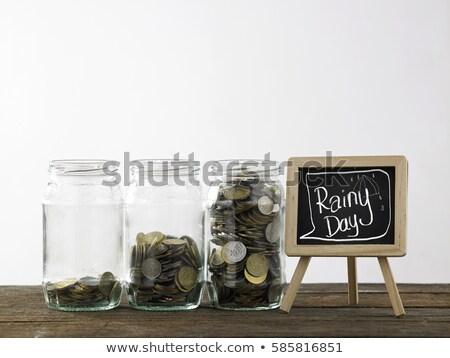 Saving for raining days  Stock photo © dezign56