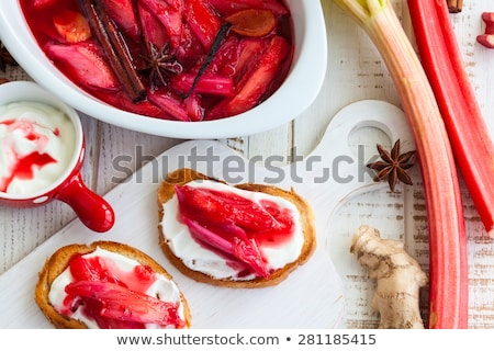 Stewed rhubarb with yogurt in a white dish Stock photo © raphotos
