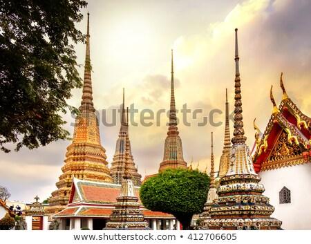pagodas of wat pho temple in bangkok thailand stock photo © kasto