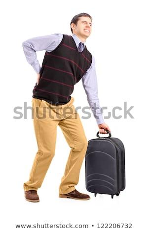 Uomo sofferenza mal di schiena bagaglio giovane Foto d'archivio © AndreyPopov