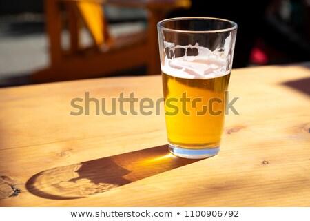 Vidro cerveja ao ar livre metade vazio sombra Foto stock © rafalstachura