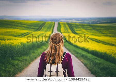 Young blonde attractive woman standing on the road stock photo © dariazu