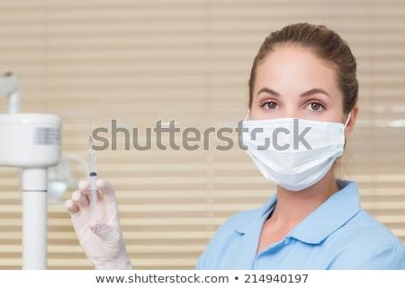 Tandheelkundige assistent injectie naar kliniek Stockfoto © wavebreak_media