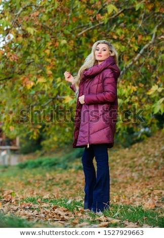 Pretty blonde picking out jacket Stock photo © wavebreak_media