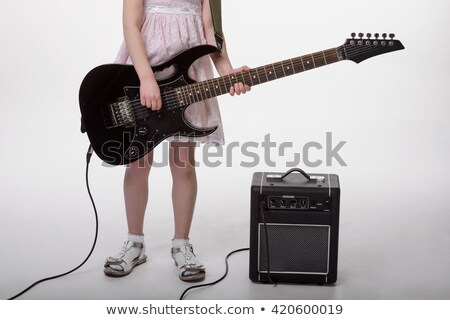 girl's legs and  hands with electric guitar  stock photo © master1305