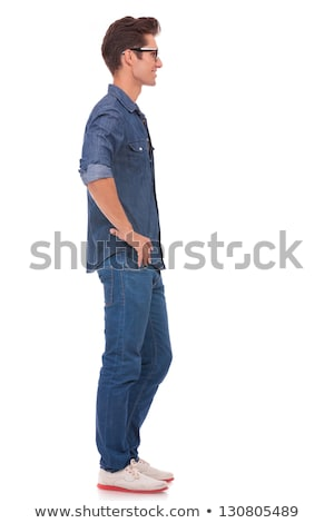 side view of a cool man with glasses standing stock photo © feedough
