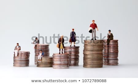 Financial concept. Business people standing on coins piles Stock photo © Kirill_M