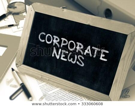 Corporate news manoscritto bianco gesso lavagna Foto d'archivio © tashatuvango