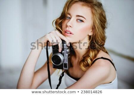 camera retro photo woman in vintage room stock photo © lunamarina