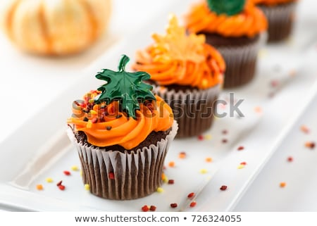 autumn chocolate cupcakes with orange and chocolate frosting and stock photo © rojoimages