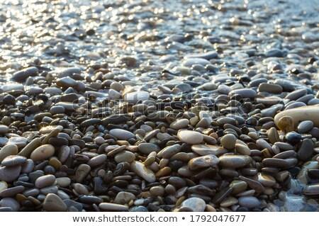 kövek · tengerpart · távoli · sziget · horizont · naplemente - stock fotó © lunamarina