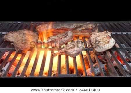 Férfi grillezés disznóhús hús barbecue természetes fény Stock fotó © stevanovicigor