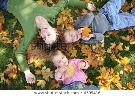 woman with the son and the daughter they lie on the grass 3 Stock photo © Paha_L