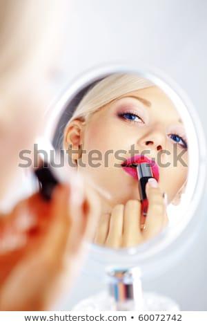 gyönyörű · lány · jelentkezik · rózsaszín · rúzs · gyönyörű · fiatal · nő - stock fotó © deandrobot