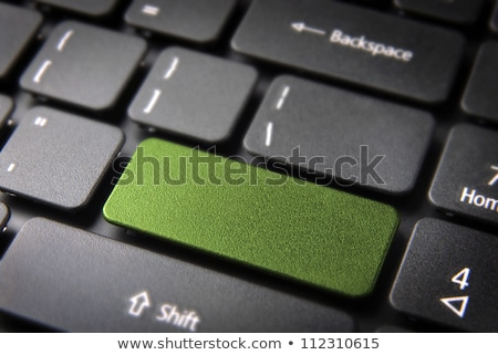 Laptop computer keyboard with blank green button Stock photo © michaklootwijk