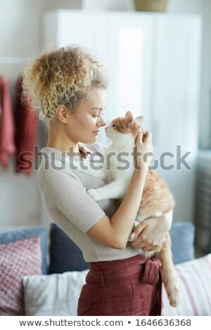 jonge · mooie · vrouw · liefhebbend · puppy · woonkamer · paar - stockfoto © Giulio_Fornasar