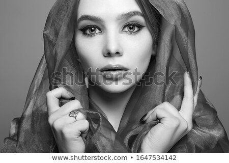 portrait of a mysterious woman in hood stock photo © konradbak