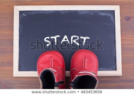 Kid scarpe parola lavoro tavolo in legno ufficio Foto d'archivio © fuzzbones0