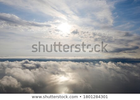 A plane flying above the sea Stock photo © bluering