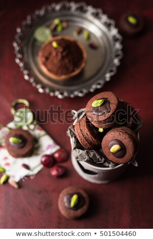 cocoa chocolate and italian pistachio nuts cookies in a tin box stock photo © faustalavagna
