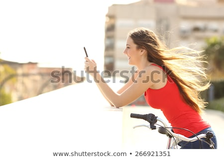 Female cyclist using mobile phone application Stock photo © stevanovicigor