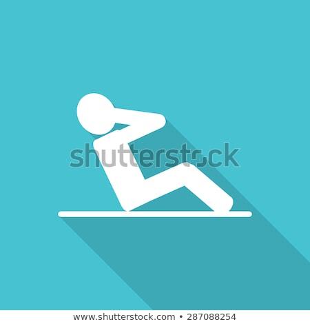 Foto stock: Man Doing Series Of Sit Ups On Black Background