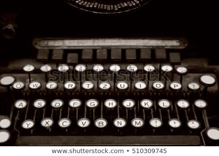 close up photo of antique german typewriter machine keys stock photo © vladacanon