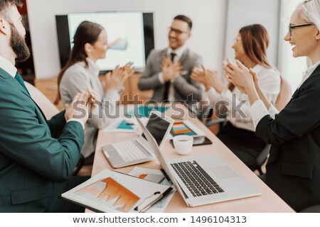 Coworkers applauding colleague at presentation Stock photo © wavebreak_media