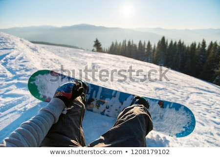 Woman with snowboard relaxing on mountain Stock photo © dash